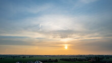 Aerial View Shot By A Drone Of A Beautiful Dramatic And Colorful Sunset At Coast Of The Lake. Nature Landscape. Nature In Europe. Reflection, Blue Sky And Yellow Sunlight. Landscape During Sunrise Or