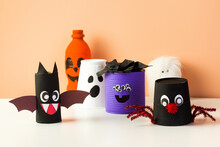 Kids DIY Halloween Home Activities. Handmade Monster, Spider And Pumpkin. Reuse Art From Tin Can, Plastic Bottle And Cup