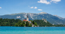 Bled Lake, Church On The Island And Castle Behind, Slovenian Alps