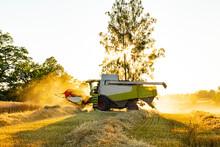 Combine Harvester Working On Field