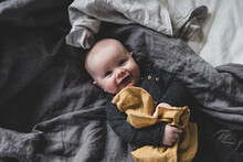 High Angle View Of Baby Lying On Bed
