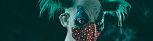 Evil Clown Wearing A Face Mask, Web Banner