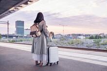 Woman Waiting At Train Station Platform