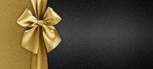Gift Card With Golden Ribbon Bow Isolated On Black Background Template With Copy Space For Merry Christmas Or Black Friday Promotional Offer