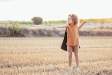 Ethnic Child In Knight Costume With Sword In Field