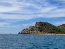 Rocky Mountain Range Shaped Like A Dog's Head Protruding From The Sea In Cu Mong Lagoon, Phu Yen