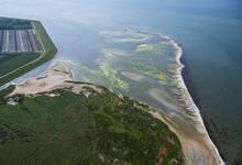 Netherlands, Zuid-Holland, Herkingen, Aerial View Of Polder And Sea