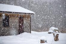 Hunters And Fisherman Country Shack In Latvia. Massive Snowfall, Big Icicle, Boat On Lake Shore