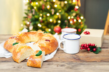 Roscón De Reyes (typical Spanish Sweet) Cut On A Wooden Table. Christmas Sweet And Dessert.