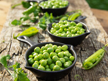 Fresh Green Peas In Bowls, On Wood Table, Seeds, Pods