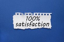 100 Percent Satisfaction, White Torn Paper With Text On Blue Background