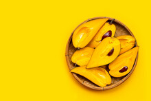 Canistel Fruit In Bamboo Basket On Yellow Background.