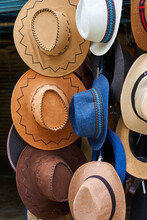 Shop With Hats Of Various Styles In The Street Market. Showcase With Hats