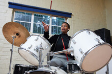 Black Woman With Short Hair Playing Drums
