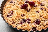 Fototapeta Kawa jest smaczna - Baking dish with tasty cherry pie on light background, closeup