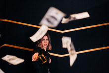 Confident Model In Jacket Among Flying Banknotes