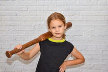 The Child A Girl With A Baseball Bat Plays A Bully