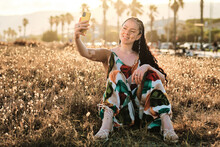 Delighted Woman With Vitiligo Taking A Self Portrait With The Smartphone On Meadow
