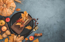 Festive Autumn Background With Cutlery, Leaves And Pumpkin On A Dark Background. Top View, Copy Space.