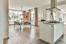 Kitchen Island And Dining Zone In Apartment