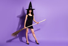 Full Size Photo Of Optimistic Nice Brunette Lady Stand With Broom Wear Black Dress Shoes Cap Isolated On Lilac Color Background