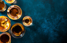 Strong Alcohol Drinks, Hard Liquors, Spirits And Distillates Iset In Glasses: Cognac, Scotch, Whiskey And Other. Blue Background, Top View