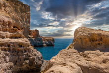 Beautiful Coast Line And Sunny Beaches In The Portuguese Region Of Algarve. Natural Caves At Carvoeiro Beach, Algarve Portugal. Rock Cliff Arches And Turquoise Sea Water