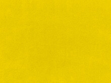 Yellow Velvet Fabric Texture Used As Background. Empty Yellow Fabric Background Of Soft And Smooth Textile Material. There Is Space For Text.