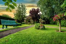Dreamlike Garden Design With Grass, Paths, Flowers And Other Plants