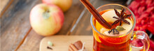 Homemade Hot Fruit Tea With Fresh Apples, Honey, Spices: Cinnamon, Cardamon, Anise, Clove. Warm Autumn Drink, Delicious Healthy Beverage. Mulled Wine. Cozy Home Atmosphere. Wooden Background, Banner
