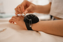 Cropped View Of Designer With Pincushion Near Cloth