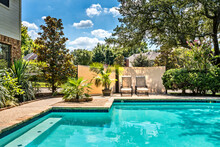 Backyard Oasis With A Swimming Pool Inside A Private Residential Backyard.