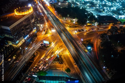 Busy highway road junction in metropolis city center at night . Transportation and infrastructure concept .