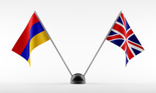 Stand With Two National Flags. Flags Of Armenia And Great Britain. Isolated On A White Background. 3d Rendering