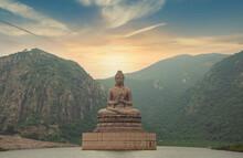 Brown Buddha Statue Near Green Mountain Under Blue Sky During Daytime Photobrown Buddha Statue Near Green Mountain Under Blue Sky During Daytime Photo