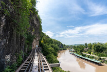 The Railway At The Foot Of The Mountain, Next To The River And Blue Sky : Tham Krasae, Kanchanaburi Province Landmark Of Thailand Location