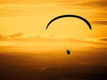 Paragliding On The Beautiful Sunset