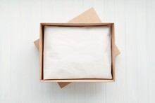 Open Cardboard Box With Packaged Product, Kraft Paper Box Mockup With Gift Inside.