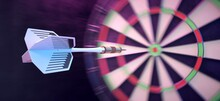 Dart Thrown With Precision Towards The Center Of The Target.