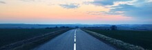 An Empty Asphalt Road (highway) Through The Fields At Sunset. Dramatic Sky. France, Europe. Transportation, Logistics, Travel Destinations, Tourism, Freedom, Wanderlust, The Way Forward Concepts