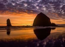 Sunset At Haystack Rock On The North Oregon Coast At Cannon Beach.