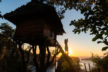 Women On Steps Of House On Tree At Atuh Beach In Nusa Penida Island, Bali In Indonesia.