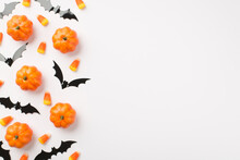 Top View Photo Of Small Pumpkins Candy Corn And Bats Silhouettes On Isolated White Background With Copyspace