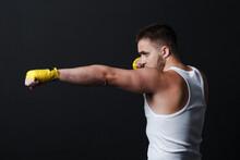 Sportsman Muay Thai Man Boxer Stance At Black Background.