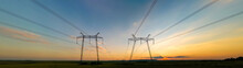 Dark Silhouette Of High Voltage Towers With Electric Power Lines At Sunrise.