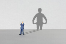 Poor Businessman. Shadow Of A Businessman With Empty Pockets Inside Out. Crisis Or Bankruptcy Concept