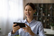 Close Up Overjoyed Woman Laughing, Looking At Smartphone Screen, Positive Excited Young Female Having Fun With Device, Watching Funny Movie Or Reading News In Social Networks, Making Video Call