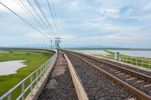 Area Of Railroad Tracks With Floating Railway Bridge Over Water Reservoir At Pa Sak Cholasit Dam, Lopburi, Thailand.