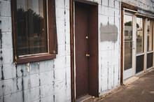 Old Rundown Urban Building And Door