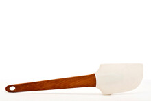 Pastry Scraping Spatula, Rubber Or Silicone Scraping Spatula With Wooden Handle For Confectionery Isolated On White Background With Space For Text